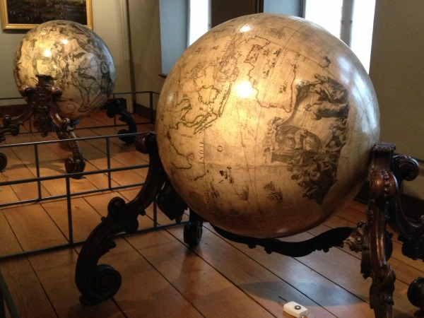 Two globes in the Musee Hospice Comtesse, Lille, France, depict two worlds – the earth and the heavens.